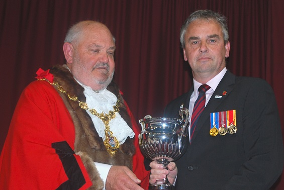 Mayor presenting Mark Strand with Millennium Cup